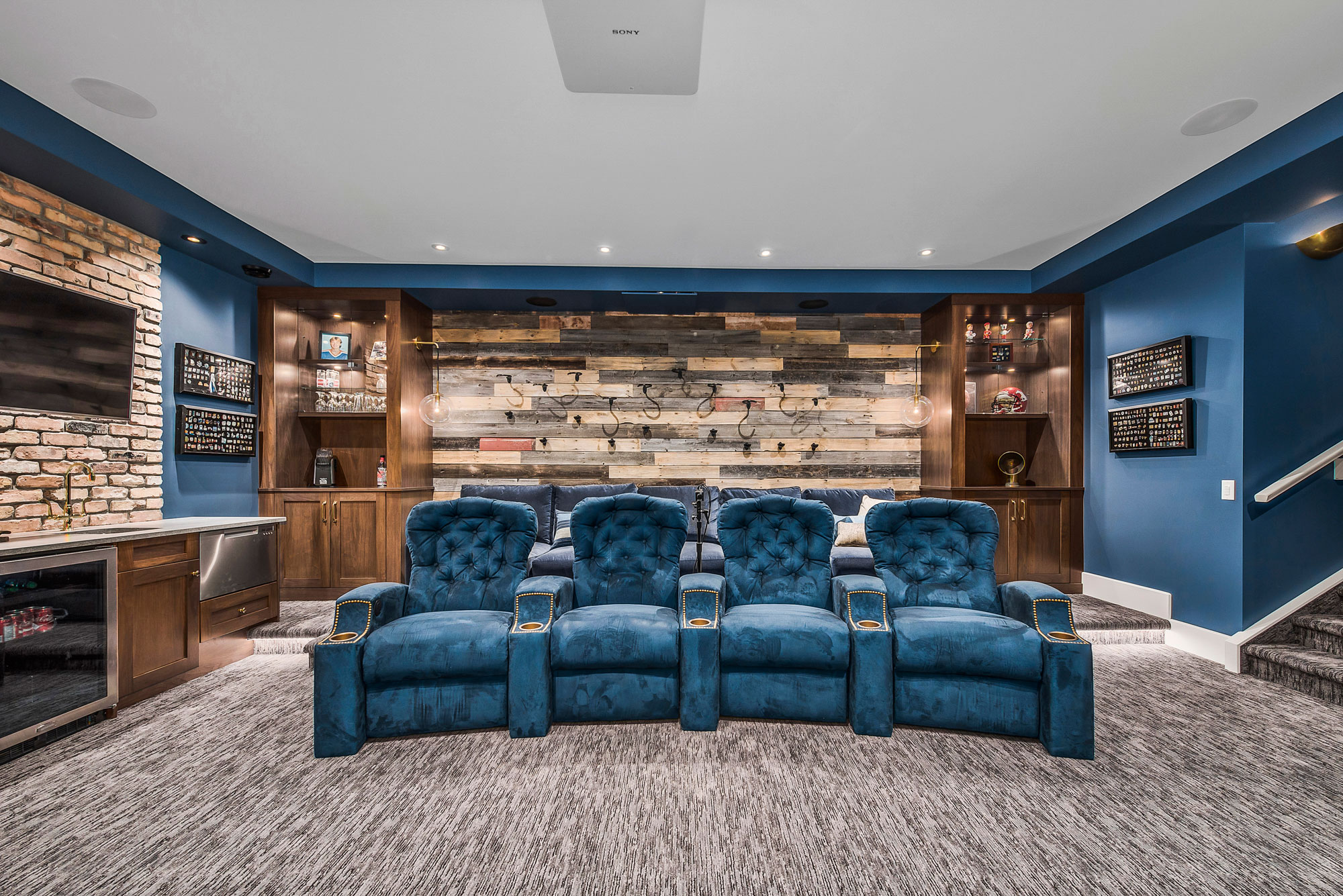 Blue luxury seating in a Media Room by Style Developments
