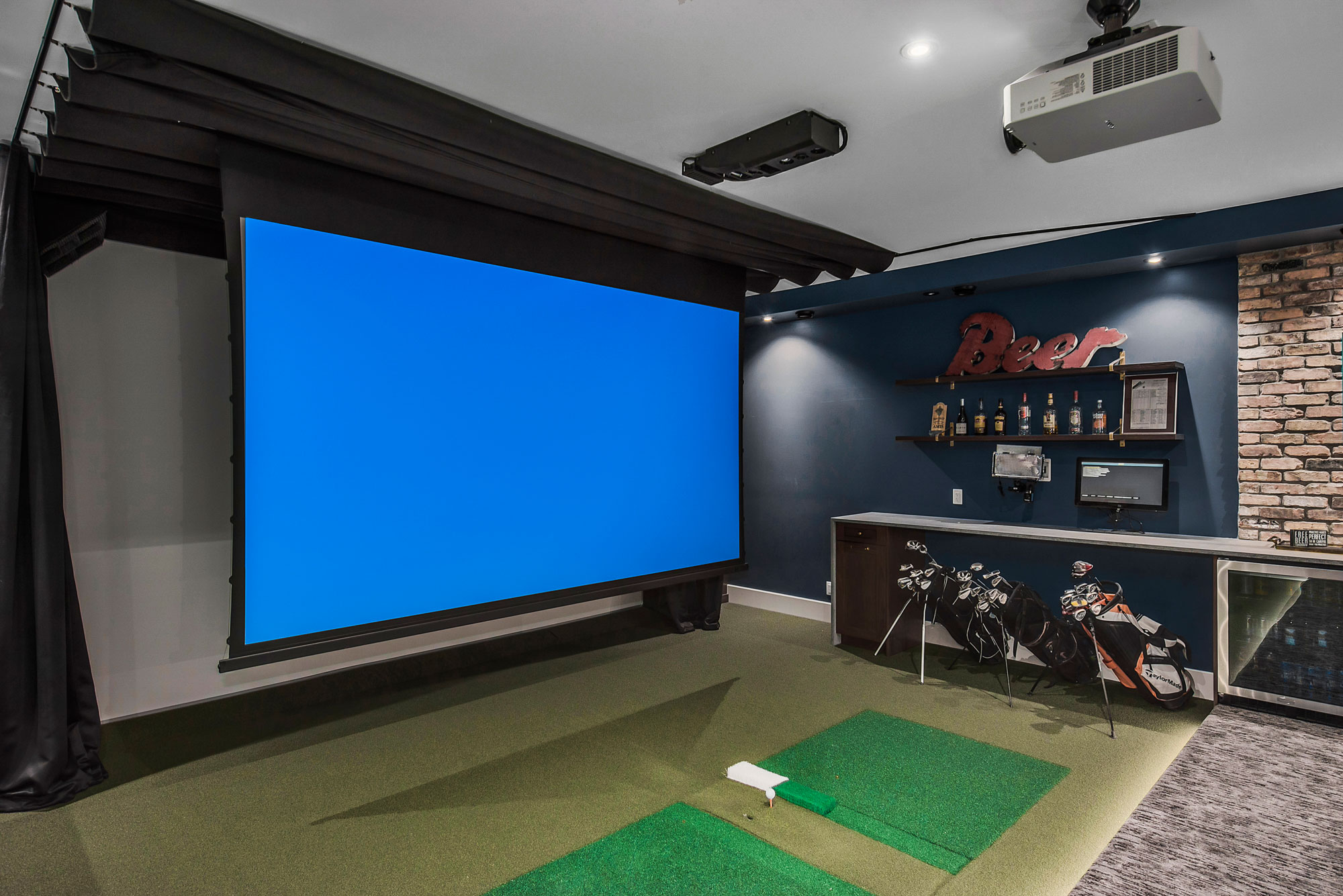 Custom Home Golf Simulator Screen by Style Developments